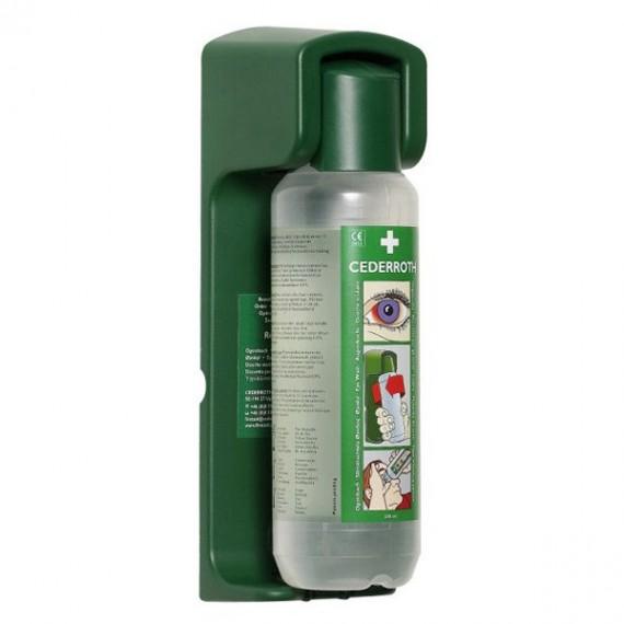 Flasken sitter fast i veggholderen og åpnes automatisk når den vris ut av holderen.